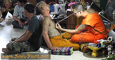 Monk is tattooing monk